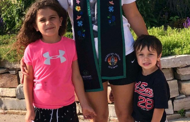 ccompanied by her children, Ciara Fineday received her American Indian graduate stole in April.