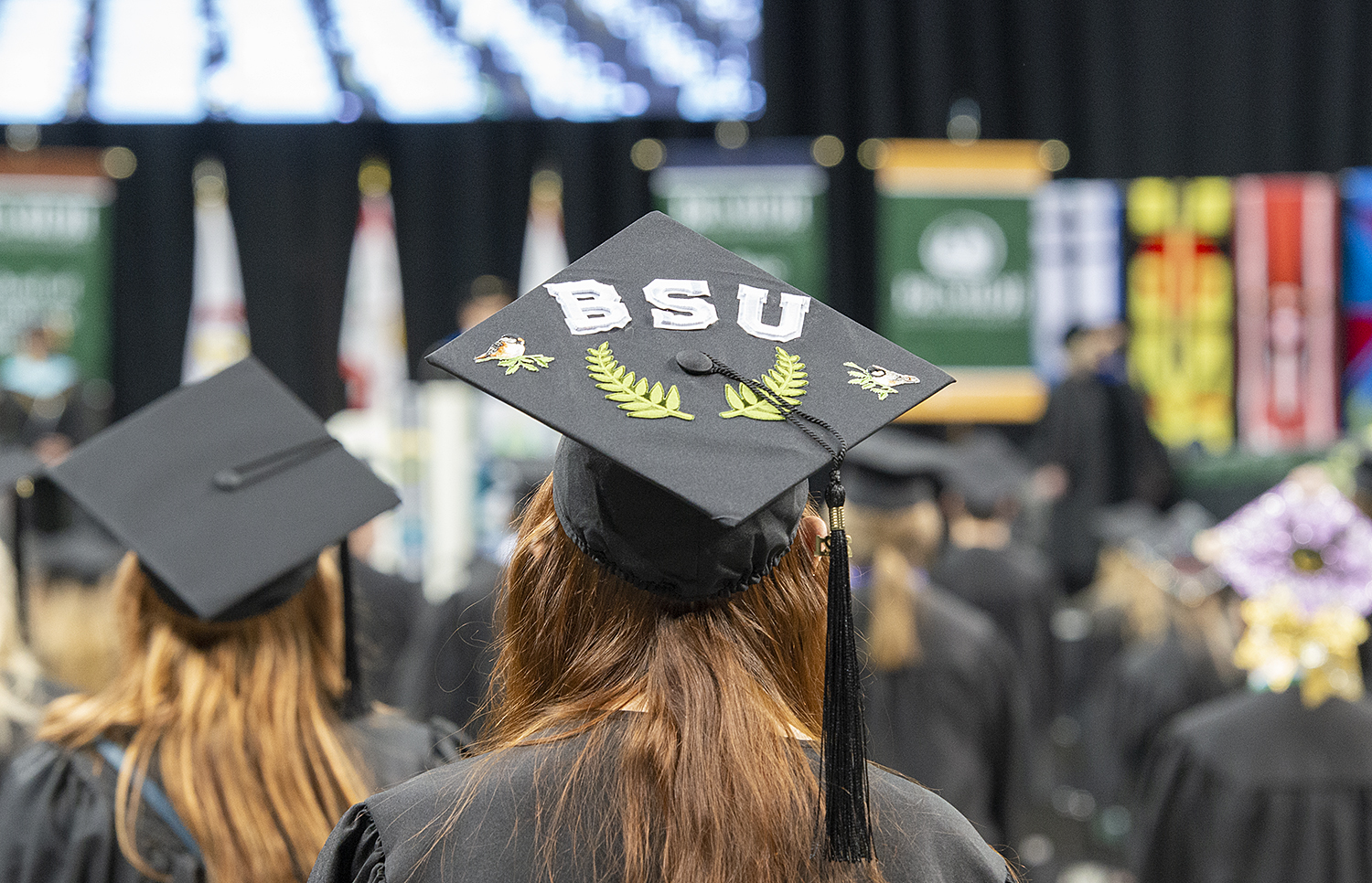 A graduate with a mortar board that says BSU