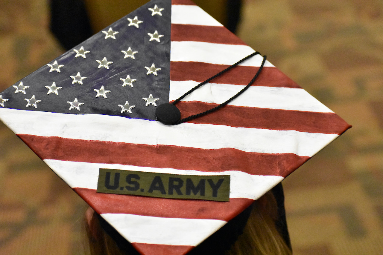 """Mortar board decorated with the American flag and says """"U.S. Army"""""""