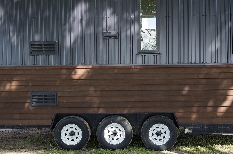 Bemidji State University tiny house Cedar beveled siding and black Pro Panel II Steel Siding.