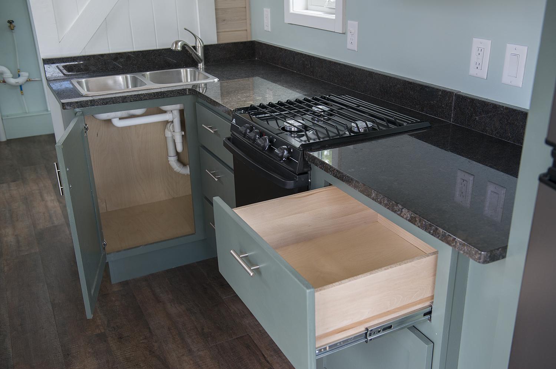Bemidji State University tiny house Granite countertops, Atwood LP gas range and slide-in cooktop.