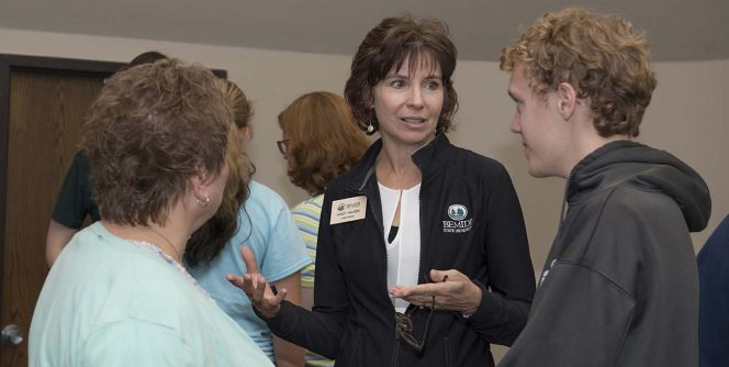 Nancy Haugen speaking with prospective students and families