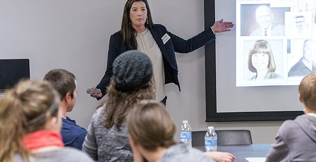 Dr. Kelly La Venture speaking at a networking event
