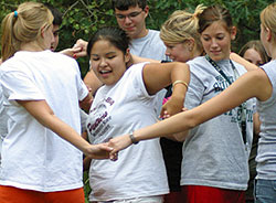 Untangle the human knot at the Low Ropes Course.