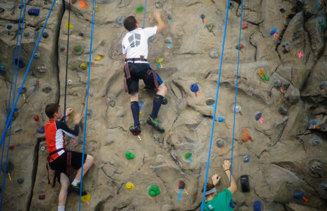 Climbing the rock wall at the Gillette Recreation Center at Bemidji State