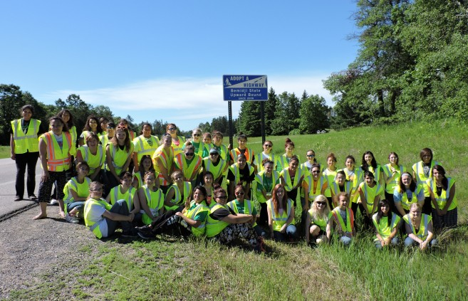 Girls clean the Upward Bound Adopt-a-Highway section